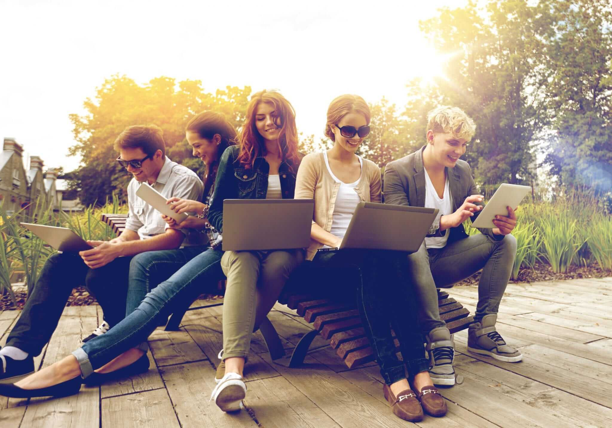Students on laptops outside